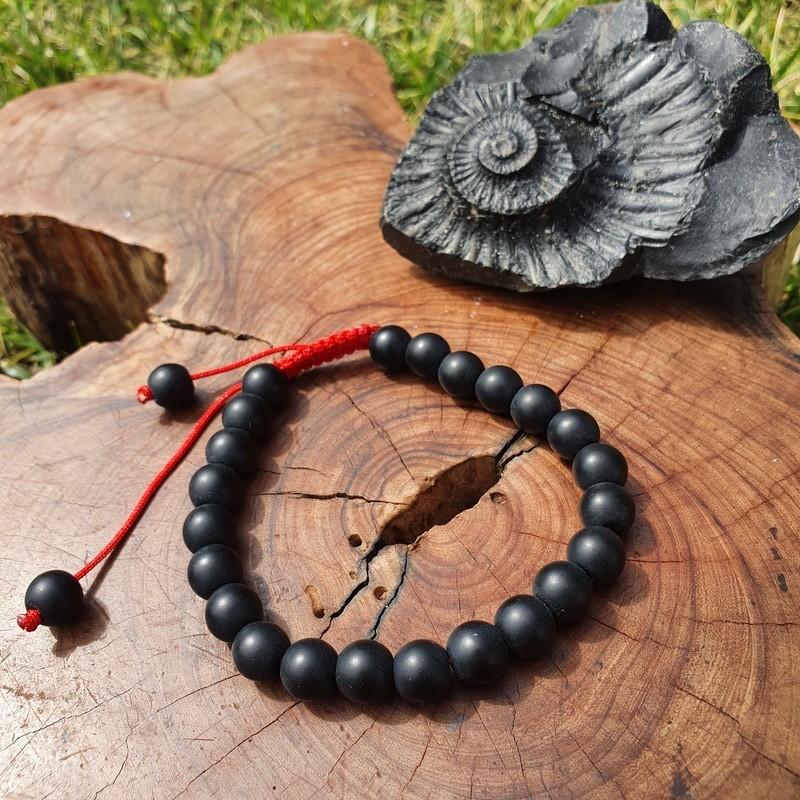 Bracelet mala tibétain en perles de shaligram